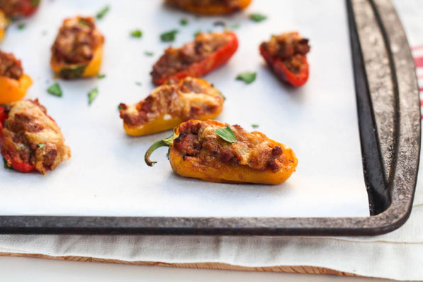Taco pepper poppers are a fun mix between tacos and  jalapeno poppers.  Sweet mini peppers make this a flavorful family-friendly (non-spicy) option for dinner, snacks, or appetizers.  Perfect healthy game-watching recipe!