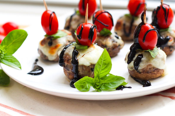 Caprese-stuffed mushroom cheeseburger bites are a fun, flavorful, and lighter appetizer perfect for football season!  #homemadenutrition #mushrooms #AD
