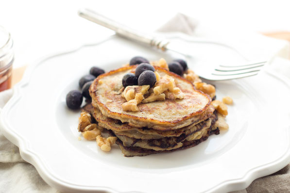 These easy gluten-free blueberry walnut banana pancakes are a healthy, high-protein (and tasty) breakfast recipe!
