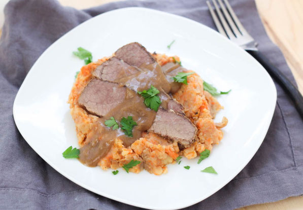 This slow cooker beef brisket with mashed potatoes, carrots, and onions is a beautiful family-friendly comfort dish!  It's a classic recipe made a little lighter and takes only a few minutes to prep!