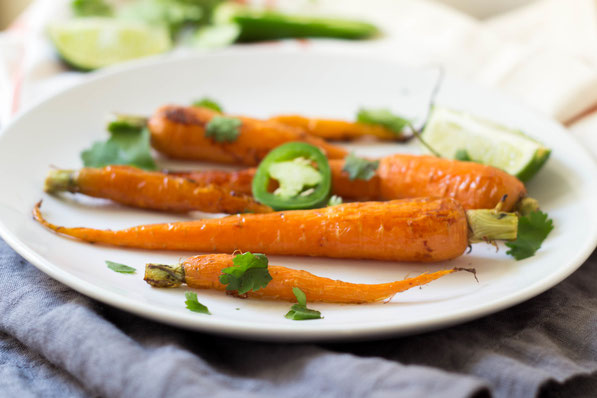 These gorgeous honey glazed carrots with lime and jalapenos are the perfect fresh spring side dish!