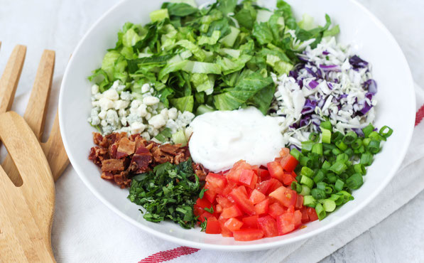 "This chopped salad is lighter than most chopped salad recipes, but still has a few ""treats"" making it a fun and delicious way to enjoy those veggies!"