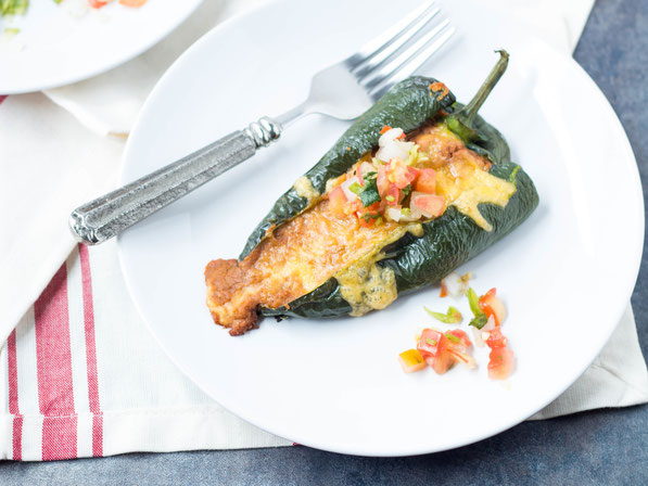 These easy vegetarian roasted poblano peppers stuffed with beans and cheese are a lighter twist on traditional chile rellenos.  They have only five ingredients and are ready in about 30 minutes!  Perfect gluten free weeknight dinner!