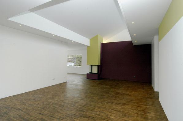 Neubau EFH Hööracker, Hallau I Wohnraum mit Cheminée