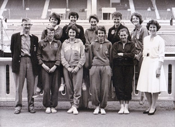 Scotland women at the 1960 WAAA Championships: (Back) Hilda McCann, Sheena Lofts, Esther Watt, Barbara Tait, Elizabeth-Mary Robertson. (Front) Anne Reilly, Alix Jamieson, Anne Wilson, Moira Kerr. Flanked by T. Williamson (coach) and J.Sinclair (Manager)