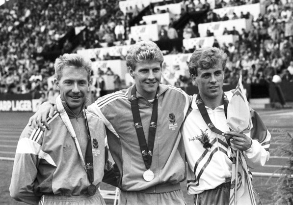 Steve Cram (middle) won a gold medal in the Men's 800m race in the 1986 Commonwealth Games at Meadowbank stadium in Edinburgh. Cram with Tom McKean of Scotland (silver, right) and Peter Elliott (bronze).  (Photo courtesy of the Scotsman)