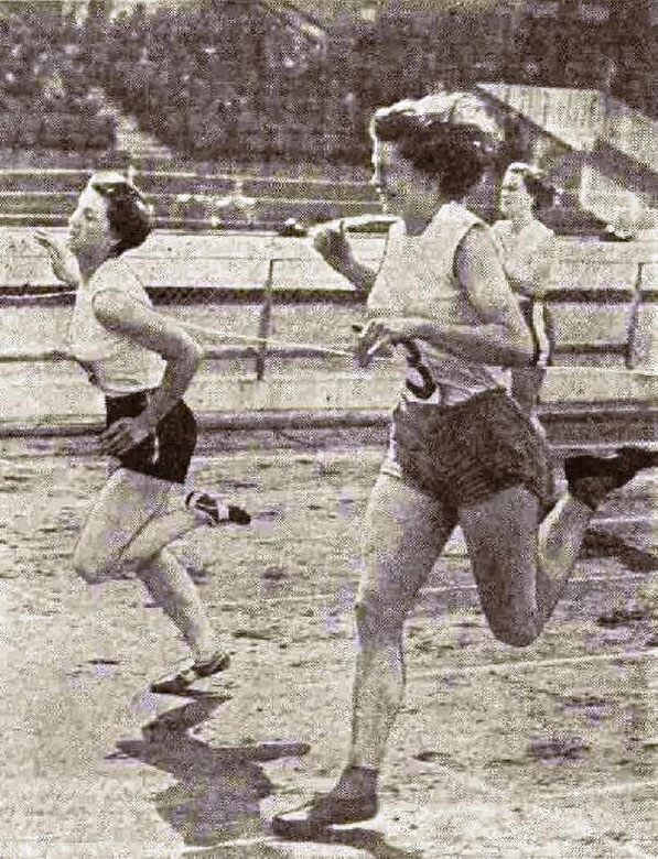 Pat Devine (on left) wins the 220 yards final from Miss B. Foster during the 1955 Caledonian Games at White City, London. Elspeth Hay is seen finishing 3rd.
