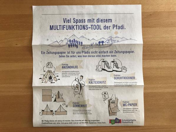 Ein Multifunktions-Tool auf Zeitungspapier. In der Pfadi findet es vielfältigen Einsatz und spricht die Abenteurer der jungen Generation (und ihre Eltern, die sich auf freie Samstagnachmittage freuen) spielerisch an.