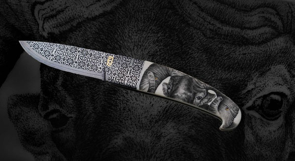 Scrimshaw in ivory on a fine damascus steel knife by Johannes Ebner