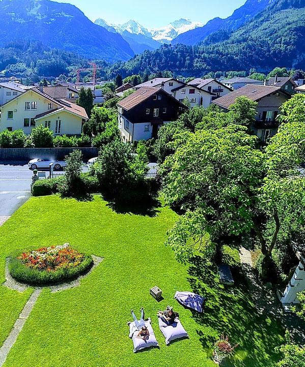 Interlaken adventure hostel garden view Eiger Mönch Jungfrau
