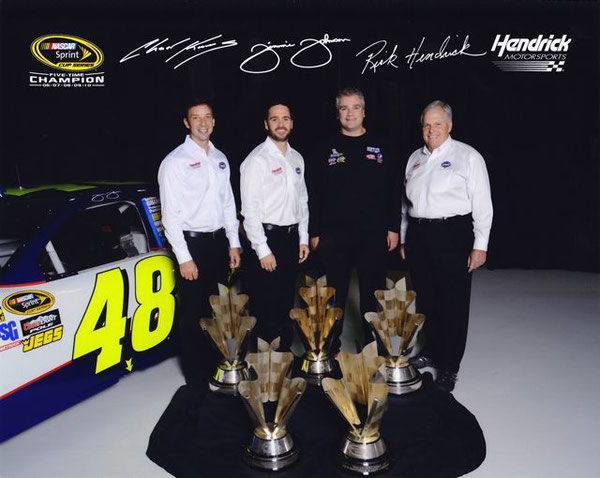 L-R:  Chad Knaus, Jimmie Johnson, Charles Macdonald, Rick Hendrick, and 5 championship trophies