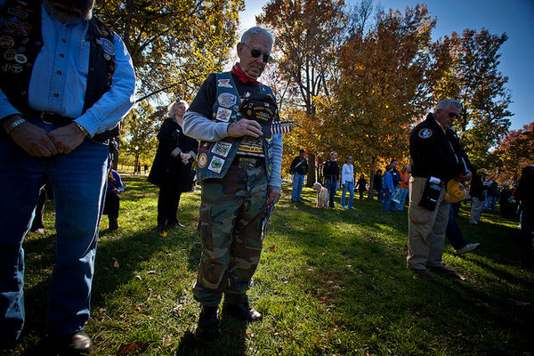 Retired Sgt. 1st Class Lou Mitchell, a Korean and Vietnam War veteran, prays during Veterans Day ceremonies at the Vietnam Veteran's Memorial Wall Nov. 11, 2010. The Dale City, Va., resident served 20