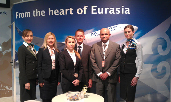 Sven Gossow (left) and Susith Hettihewa (standing right next to Sven) among the Air Astana team at ITB / source: Claasen Com.