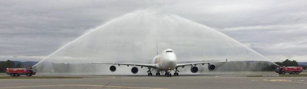 DHL wet-leased Atlas Air Boeing 747-400F was welcomed by Oslo Gardemon Airport's fire brigade last Friday upon its launching flight  -  courtesy: DP-DHL