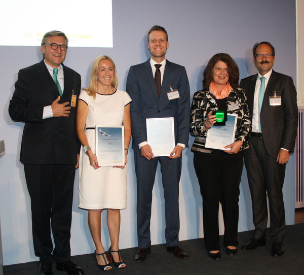Lufthansa Cargo's exects Harald Zielinski (left) and Karl-Rudolph Rupprecht (far right) awarded Panalpina's Lindsay Zingg (second from left), Maximilian Peiker of DHL (center) and Andrea Schoen of Schenker prices for outstanding environmental activities