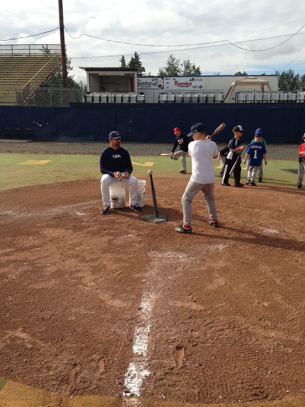 Rob Shabansky Head Coach Gateway Community College in Phoenix Arizona working with a camper at Goldpanner Park Fairbanks Alaska July 2013