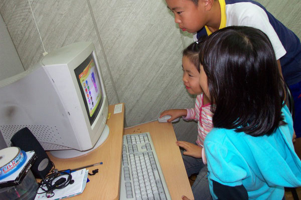 Having fun using our computer room for learning English.