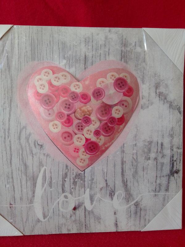Bild mit aufgesetztem Herz aus Metall