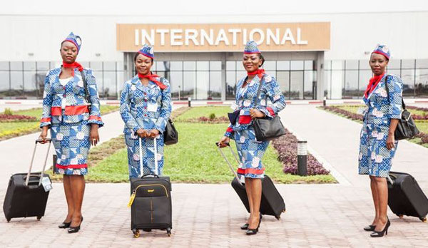 Flight attendants of the Congolese start-up are proudly presenting their new uniforms.
