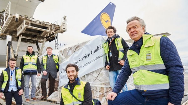 "Stephan Haltmayer (standing, right) was on hand at the loading of his client's first shipment on LH Cargo's B777F ""Hallo Germany"" – courtesy of LHC"