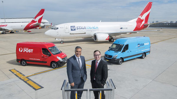Australia Post CEO, Ahmed Fahour (standing left) and Qantas CEO, Alan Joyce with StarTrack B737F aircraft livery.