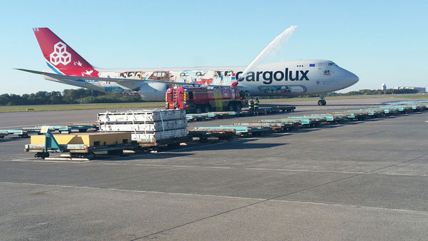 Luxembourg Airport's fire brigade welcomed Cargolux's newest fleet member with a traditional water shower  -  picture hs