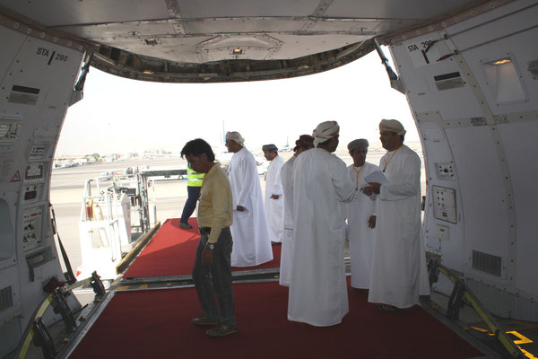 Omani officials awaiting the first transshipment at Muscat airport  /  source: hs