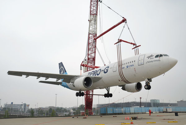 A huge crane lifted the 'Zero Gravitation' Airbus to its final parking position at CGN  /  courtesy: CGN