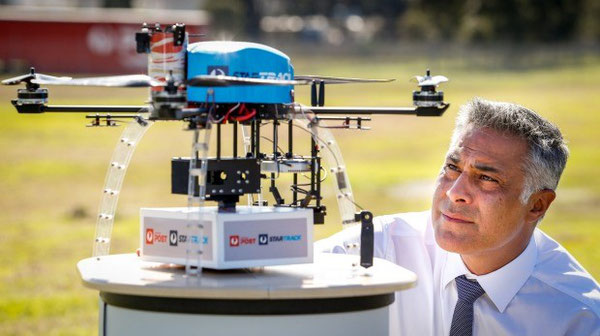 Australia Post chief executive Ahmed Fahour with one of the drones that will be used in the trial.