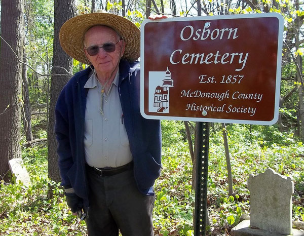 Dick Jackson accepts a sign for the Osborn Cemetery in Industry Township.
