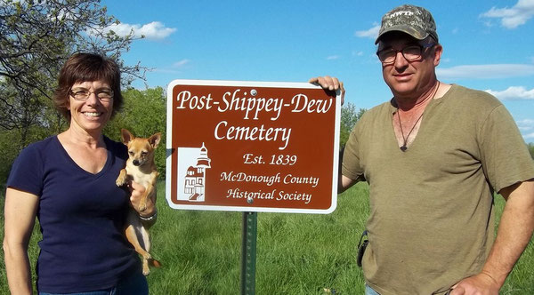 Ann and Kendall Knowles accept a new sign for the Post-Shippey-Dew Cemetery, located on their property.