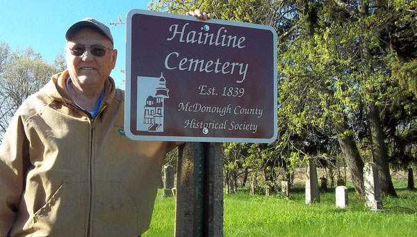 Dick Hainline accepted a new sign marking the relocated graves of his descendants. It has been mysteriously removed.