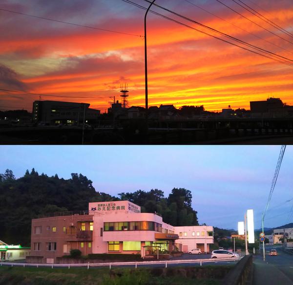 (写真上)当院のある三重町トキハ通りから西側を見た茜色の夕焼け。左に豊後大野市役所や、中央にNTTの電波塔が写っています。(写真下)夕焼けに照らされて薄紅色に映える当院です。写真右に豊後大野警察署、左側に三重調剤薬局が見えます。