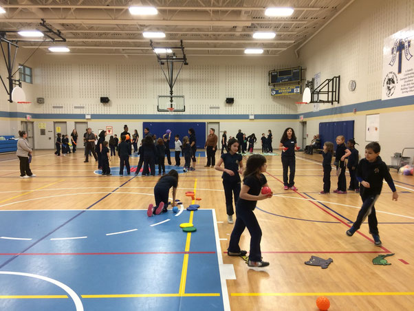Recess LEADers play games with younger students