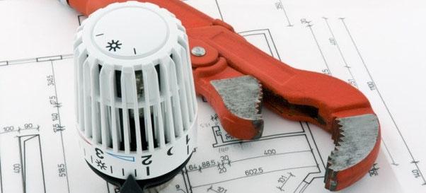 Titelbild Haustechnik Jäger,  Thermostatkopf und Rohrzange
