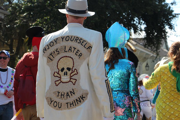 Krewe of Red Beans parade, March 4, 2019 (Aurélie Godet). Most of the red beans were painted in black and white and applied to the jacket with a glue gun.