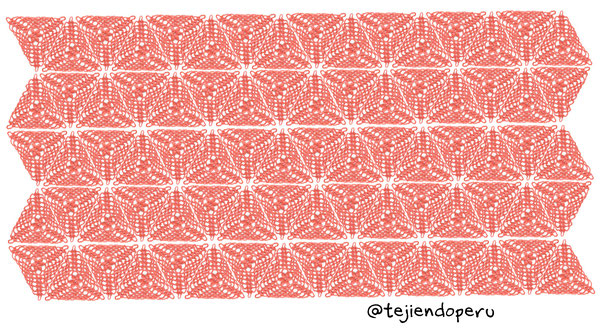 Mantel tejido a crochet con triángulos con flores puff