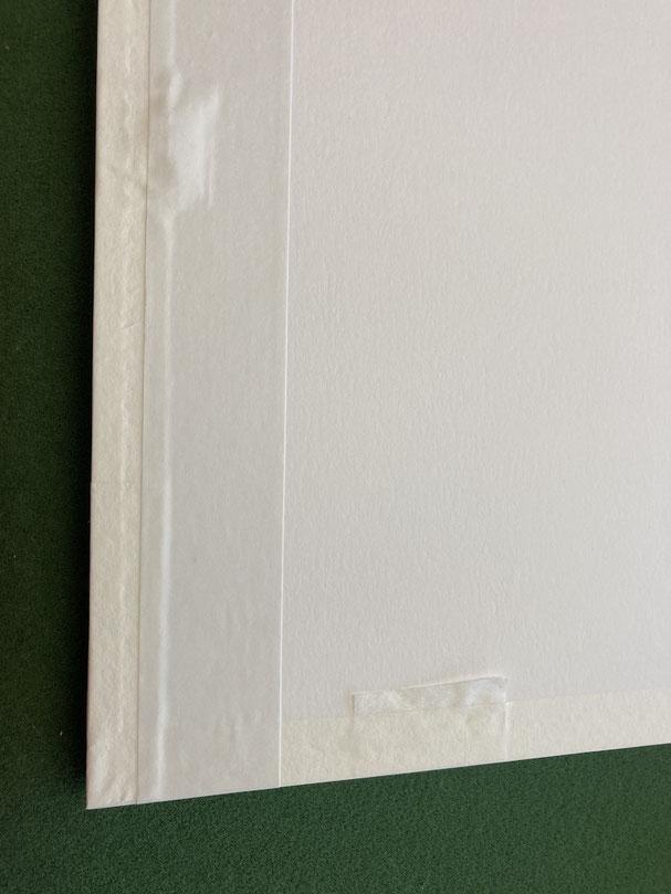 Einrahmung von Foto: Päckli, Rückenkarton wird staubdicht abgeklebt.