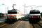 """En gare de St Quentin, la BB 22302 (maintenant en livrée """"Infra"""") et la BB 15026, toujours dans la livrée """"Corail +"""" mais modifiée MUX 1. Septembre 2000 - Photo MB"""