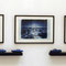 """Blue cars blue landscape"", 1991, 3 Photos, 4 scaled model cars, wood, iron shelf. sign. €  3.500"