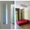 Wohnraum mit Spiegel im Flur und Blick in`s Kinderzimmer / Sofa als Doppelbett / Küche mit blauer Wand