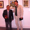 profesor Cesar Aldana y su pupilo Pepe Saldarriaga con obra del maestro