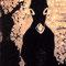 「黒装束の女のロバ」 板、墨、木彫 2010