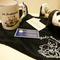 キャサリン様・お店の名刺とTシャツと木彫りパンダのテープストッカー