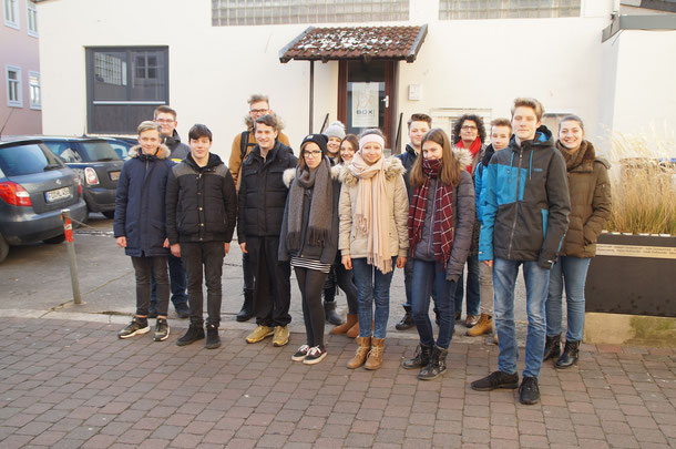 Students group with teacher Listmann in front of the place of the destroyed synagogue, today a parking lot.