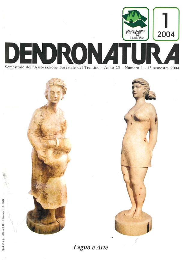 Foto copertina: due opere lignee di Livio Tasin.