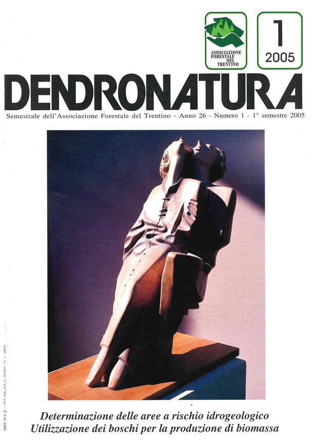 Foto copertina: Amanti, un'opera di Livio Conta, in legno policromo