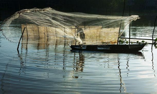 Fischer auf dem Mekong Fluss