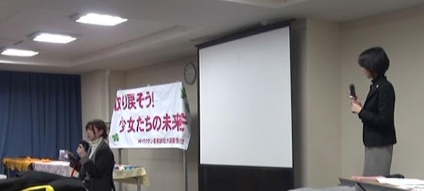 報告集会で今の気持ちを語る谷口さん