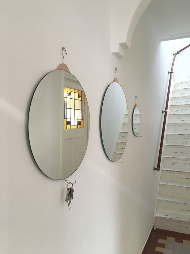 A Mirror With Clothes Hooks To Hang Your Keys Or Jewelry